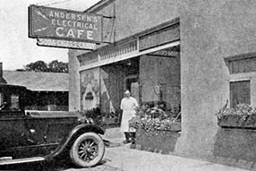 The old Electric Cafe with Anton in standing in front.